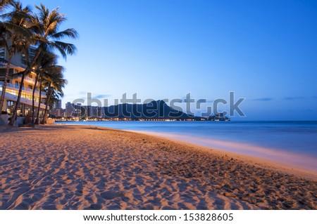 A Waikiki sun rising over Diamond Head, Hawaii - stock photo