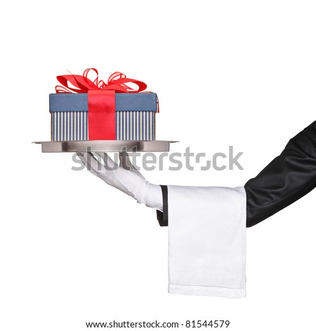 A waiter holding a silver tray with a gift on it isolated on white background - stock photo