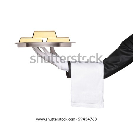 A waiter holding a tray with gold bars on it against white background - stock photo