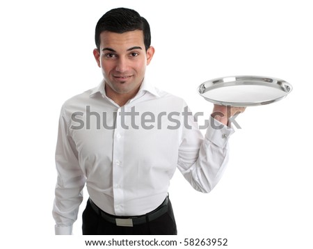 A waiter or bartender, or servant holding a round silver tray and smiling.  White background. - stock photo
