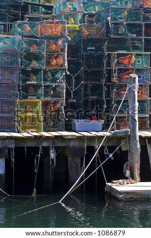 A walk along the oceanfront streets in Portland, Maine yields beautiful pictures of lobster traps, ropes, lobster boats, colorful bouys a breathtaking landscapes. - stock photo