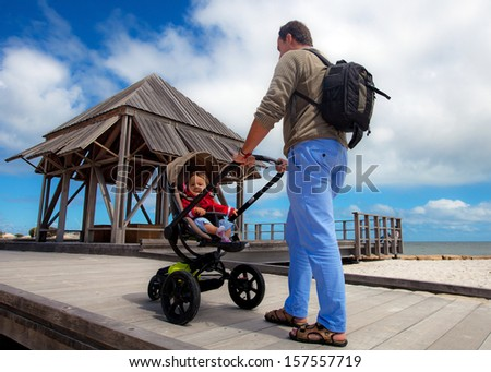 A walk in the beach of Fremantle with a baby, Western Australia - stock photo