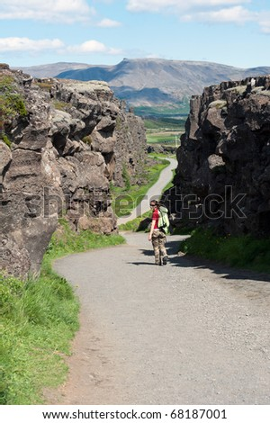 a walk in the Canyon Almannagja between the Eurasian and North American tectonic plates, Iceland - stock photo