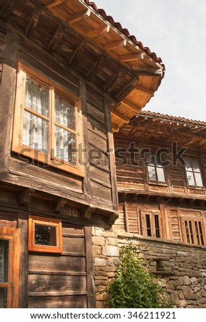 A walk through the past. Old wooden houses in small village in Eastern Europe.
