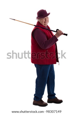 A walking female senior looks to viewer 3 - stock photo