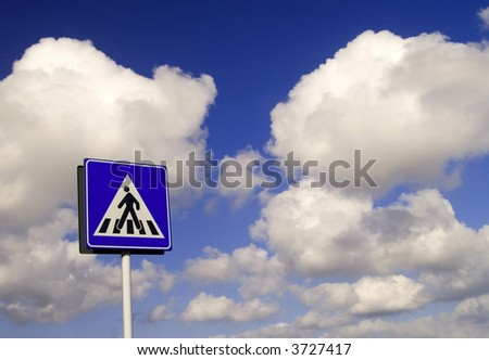 a walkway sign against a cloudy background