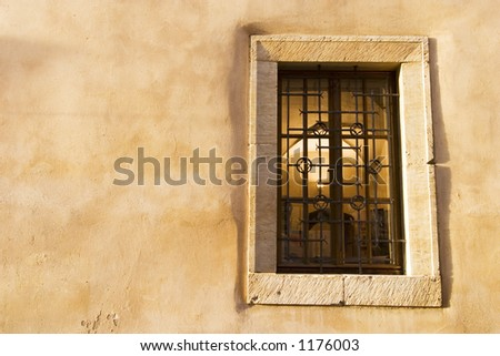 A wall abstract with people walking by. - stock photo