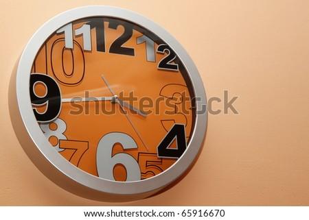 a wall clock orange - stock photo