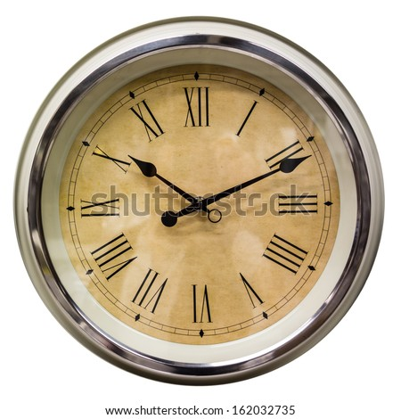 a wall clock with roman numbers isolated on a white background - stock photo