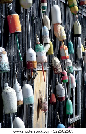 A wall full of colorful lobster buoys on Mount Desert Island in Maine