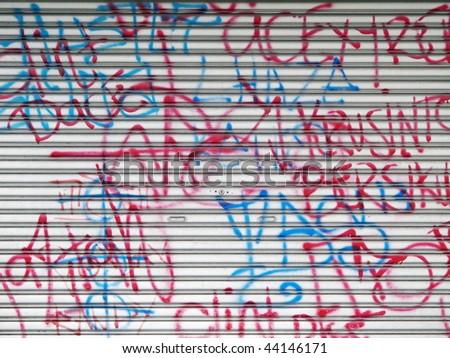 A wall full of graffiti signs - stock photo