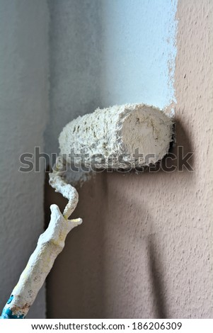 a wall in an apartment is repainted - stock photo