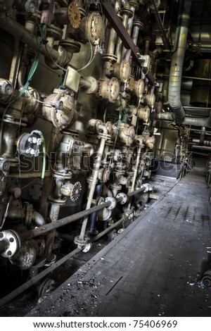 A wall looking like a maze of tubes, turns, and valves. An industrial grunge scenery.