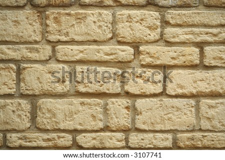 A wall made from traditional English Cotswold stone - stock photo