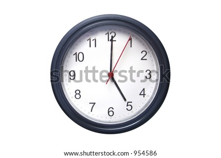 A wall mounted clock showing 5 o'clock - stock photo