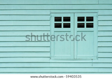 a wall of a shed with doors - stock photo