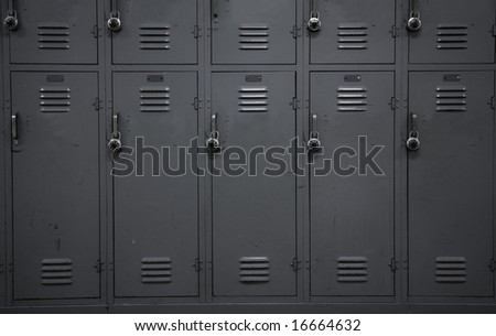 A wall of gray school lockers typical of an American public high-school - stock photo