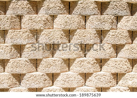 A wall of interlocking stone blocks for background or texture - stock photo