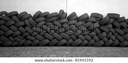 A wall of old car tires
