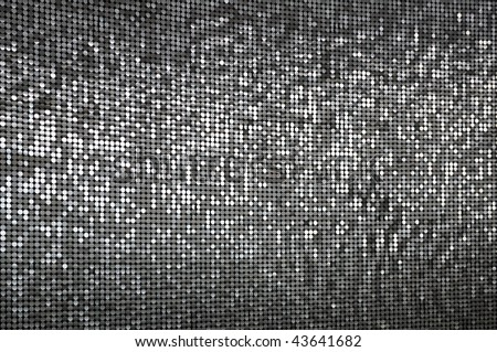 a wall of sparkling silver sequins - stock photo