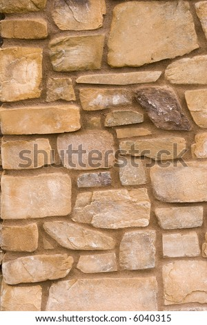 A wall of stone blocks useful as a background