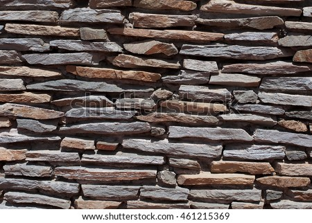 A wall of stone plates