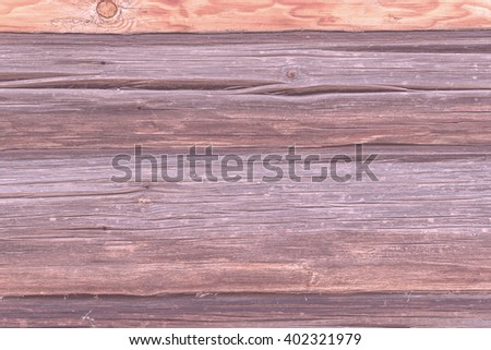 a wall of wood, timber, uneven pale red wooden surface - stock photo