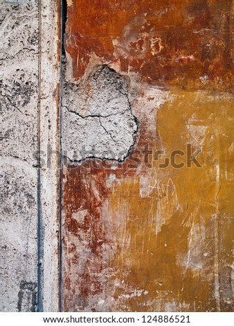 A wall with a hole that has been patched