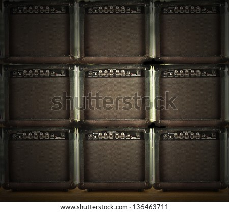 A wall with nine amps for guitar - stock photo