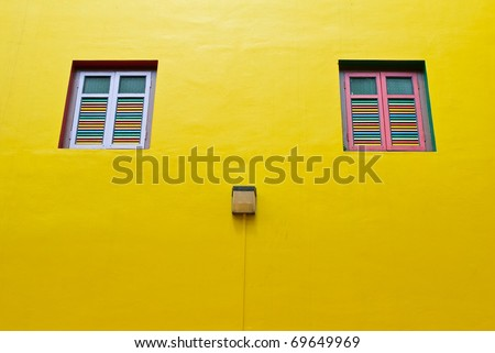 A wall with two windows in Singapore