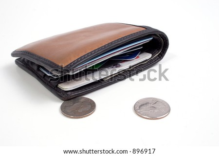 a wallet and a few coins - stock photo