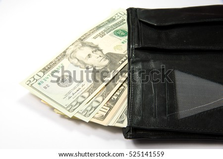 A wallet and dollars