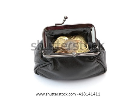 A wallet filled with euro coins - stock photo