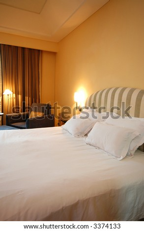 A warm and cosy bedroom during vacation - stock photo