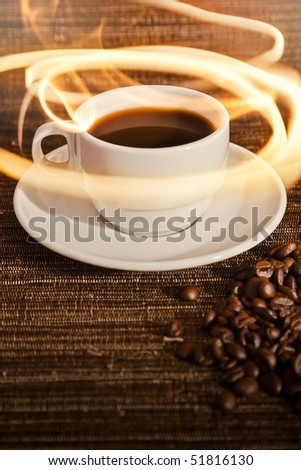 A warm cup of warm coffee on a dark brown textured background. - stock photo