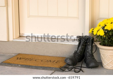 A warm welcome for visitors to your home.  Take off your boots and set a spell! - stock photo