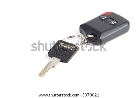 A warn car key and remote on white with shadows