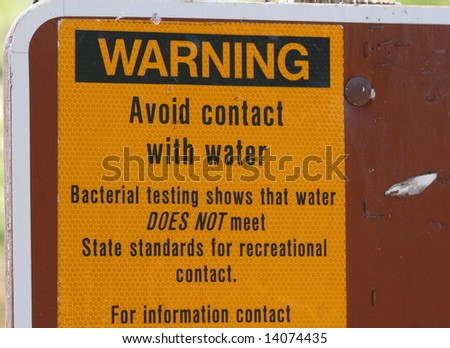 A Warning Avoid Contact with Water Sign - stock photo