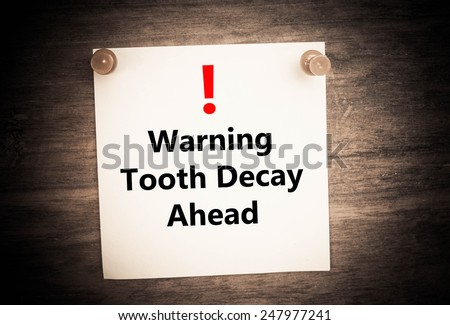 a warning of Tooth Decay ahead concept concept on note paper - stock photo