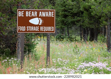 A warning sign to be aware of bears in the back country - stock photo
