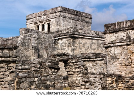 A warren of walls and ruined buildings forms a small complex of Mayan origin at Tulum, Quintana Roo, Mexico. - stock photo