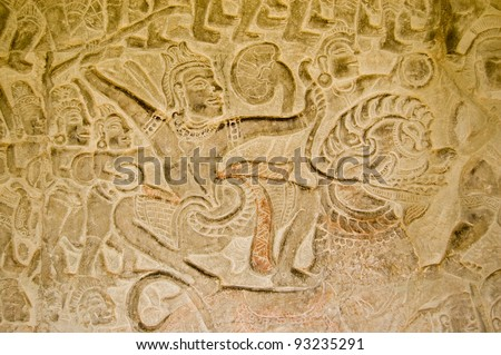 A warrior armed with a sword in battle while riding a Chinese lion.  Bas relief carving in the Vishnu and the Asuras gallery, Angkor Wat temple, Siem Reap, Cambodia.