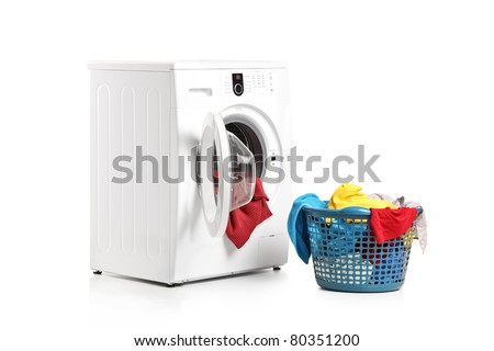A washing machine and full laundry bin isolated on white background - stock photo