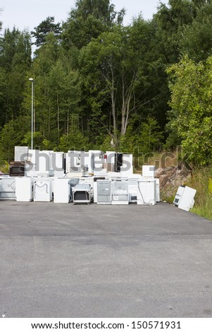 A waste disposal facility with fridges - stock photo