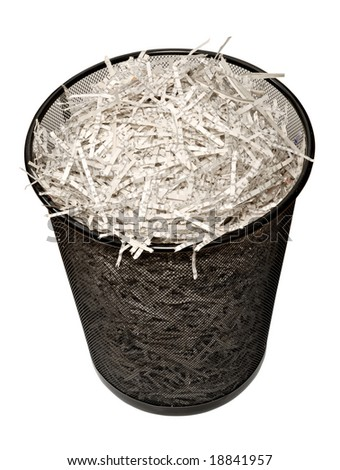 A wastebasket filled with shredded paper. Isolated on a white background with clipping path. - stock photo