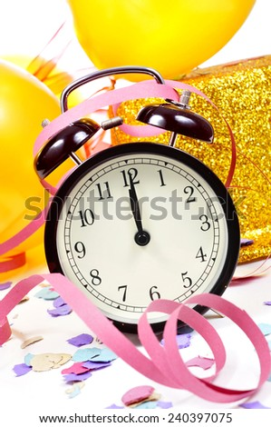 a watch at twelve, balloons, a golden top hat, streamers and confetti for the new years party - stock photo