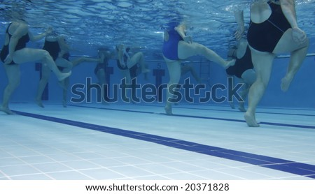 A water aerobics class. Underwater picture.