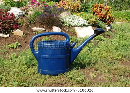 A water can in the garden - stock photo