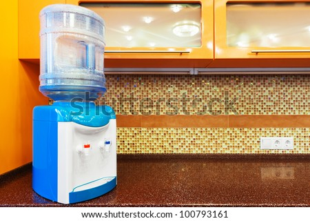 a water cooler on the modern kitchen - stock photo