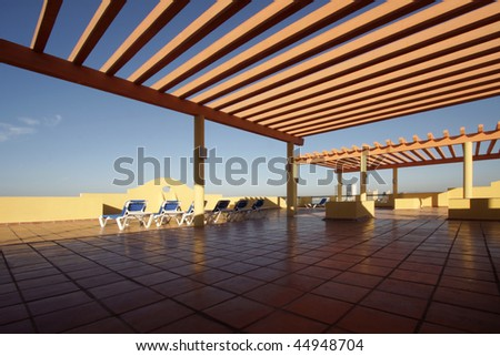 A water-front deck in a sunny afternoon - stock photo